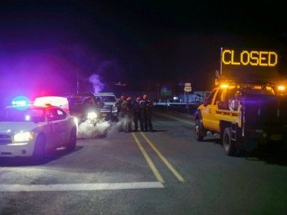 Law enforcement personnel monitor an intersection of closed Highway 395 in Burns, Oregon on January 26, 2016, during a standoff pitting an anti-government militia against the US authorities. One person died in an armed clash with police as they arrested the leaders of a group laying siege to an American …