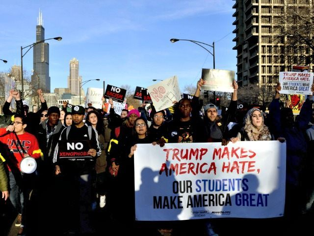 Protestors march in Chicago on Friday, March 11, 2016, before a rally with Republican presidential candidate Donald Trump at the University of Illinois-Chicago. (AP Photo/Matt Marton)