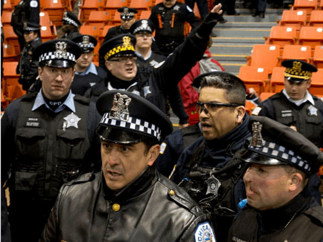 Chicagio police arrive as anti-Trump protesters take over during a Trump rally at the UIC Pavilion in Chicago on March 11, 2016. Republican White House hopeful Donald Trump cancelled his appearance at a Chicago rally Friday amid extraordinary scenes of chaos, with hundreds of protesters clashing with the frontrunner's supporters and police struggling to maintain order. / AFP / Tasos Katopodis 2016 (Photo credit should read