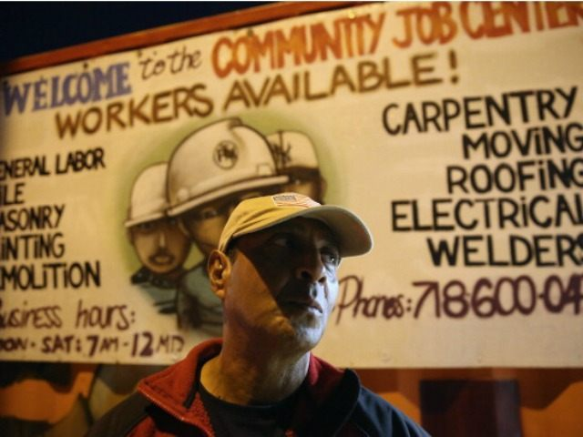 Colombian immigrant Luis Morales stands outside the Bay Parkway Community Job Center on September 28, 2013 in the Brooklyn borough of New York City. The center, part of the Workers Justice Project, provides shelter and wage negotiation services for immigrant day laborers who normally wait for work on street corners …