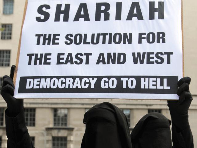 Muslim protestors demonstrate in Whitehall London