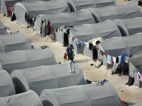 Kurdish refugees live in tents in a refugee camp