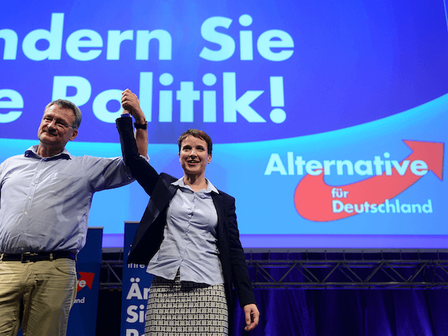ESSEN, GERMANY - JULY 4: Frauke Petry, the new Chairwoman of the AfD (Alternative fuer Deutschland) and Jorg Meuthen the new co-Chairman receive at the AfD federal party congress on July 4, 2015 in Essen, Germany after the Election congretulations.