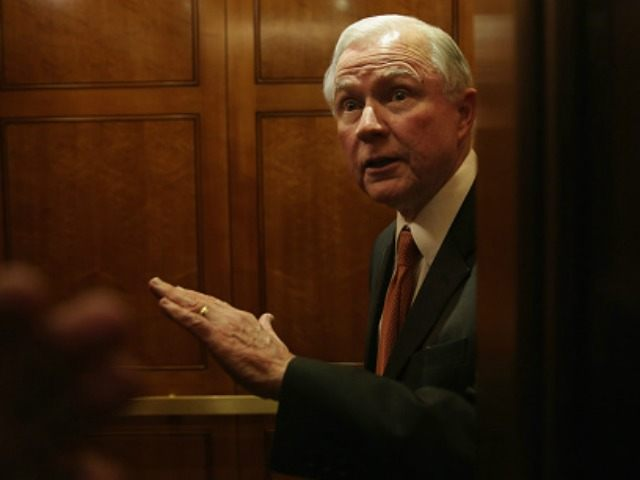 Sen. Jeff Sessions (R-AL) speaks to members of the media from inside an elevator after the weekly Senate Republican Policy Luncheon February 24, 2015 on Capitol Hill in Washington, DC.