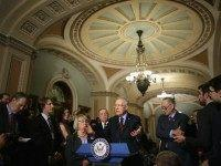 Senate Minority Leader Harry Reid (D-NV) (C) answers reporters' questions duirng a news conference with (L-R) Sen. Patty Murray (D-WA), Senate Minority Whip Richard Durbin (D-IL) and Sen. Charles Schumer (D-NY) following the weekly Senate Democratic policy luncheon in the U.S. Capitol December 8, 2015 in Washington, DC.