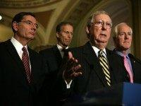 Senate Majority Leader Sen. Mitch McConnell (R-KY) (3rd L) speaks as (L-R) Sen. John Barrasso (R-WY), Sen. John Thune (R-SD), and Senate Majority Whip Sen. John Cornyn (R-TX) listen during a news briefing after the weekly Republican policy luncheon March 8, 2016 on Capitol Hill in Washington, DC.