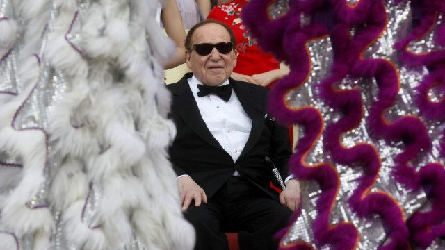 Las Vegas casino magnate Sheldon Adelson watches a performance at the Sands Cotai Central in Macau in April.