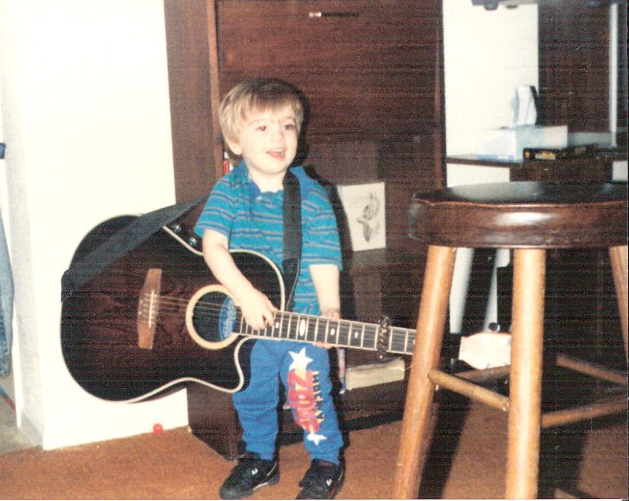 Spencer playing guitar as baby-1
