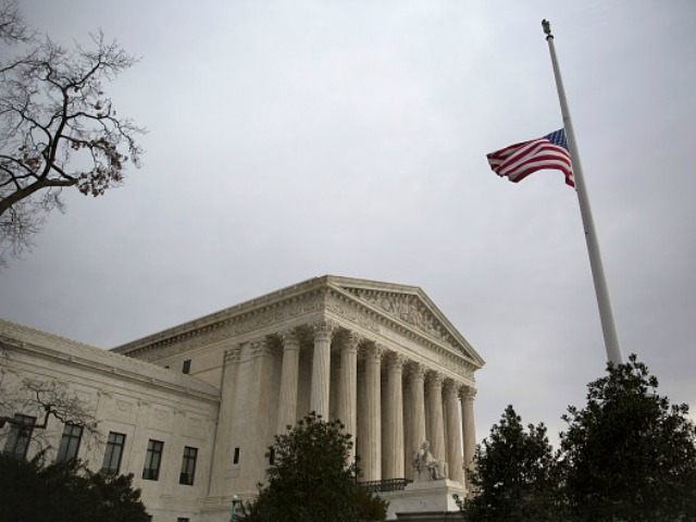 The American flag flies at half-staff at the U.S. Supreme Court, February 19, 2016 in Washington, DC.