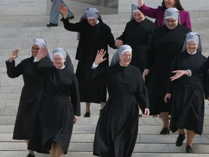 Mother Loraine Marie Maguire, (C), of the Little Sisters of the Poor, walks down the steps of the US Supreme Court after aruments, March 23, 2016 in Washington, DC.