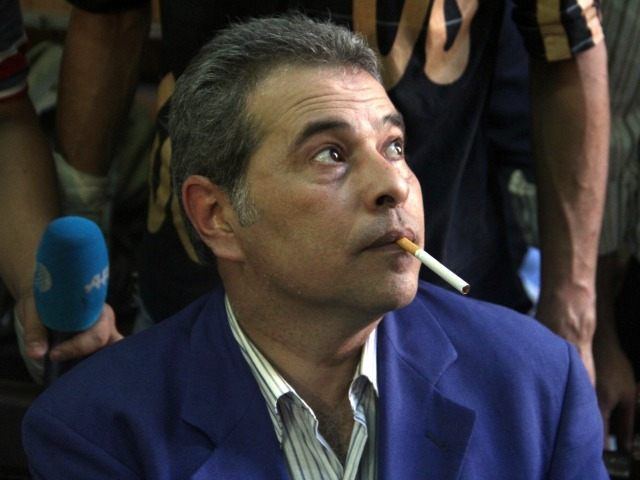 Egyptian talk show host Tawfiq Okasha attends his trial on charge of calling for the murder of President Mohamed Morsi, on September 1, 2012 in Cairo.