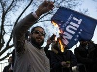 protester burns a flag outside of the University of Illinois at Chicago Pavilion where Republican presidential candidate Donald Trump is due to speak at a campaign rally March 11, 2016 in Chicago, Illinois. The rally was later cancelled for safety concerns.