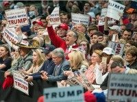 Caption:CONCORD, NC - MARCH 7: Donald Trump supporters cheer on the Republican presidential candidate before a campaign rally March 7, 2016 in Concord, North Carolina.
