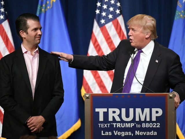 : Donald Trump Jr. (L) looks on as his father, Republican presidential candidate Donald Trump, speaks at a caucus night watch party at the Treasure Island Hotel & Casino on February 23, 2016 in Las Vegas, Nevada.