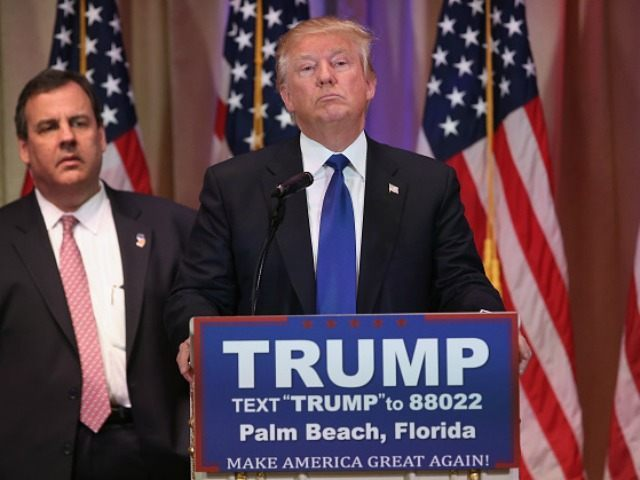 Republican Presidential frontrunner Donald Trump listens to a reporter's question at his Mar-A-Lago Club on Super Tuesday, March 1, 2016 in Palm Beach, Florida. Trump held a press conference, flanked by New Jersey Governor Chris Christie)