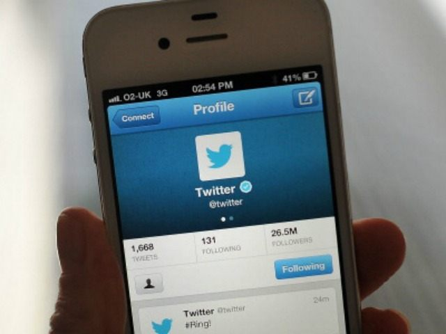 In this photo illustration, the Twitter logo and hashtag '#Ring!' is displayed on a mobile device as the company announced its initial public offering and debut on the New York Stock Exchange on November 7, 2013 in London, England.