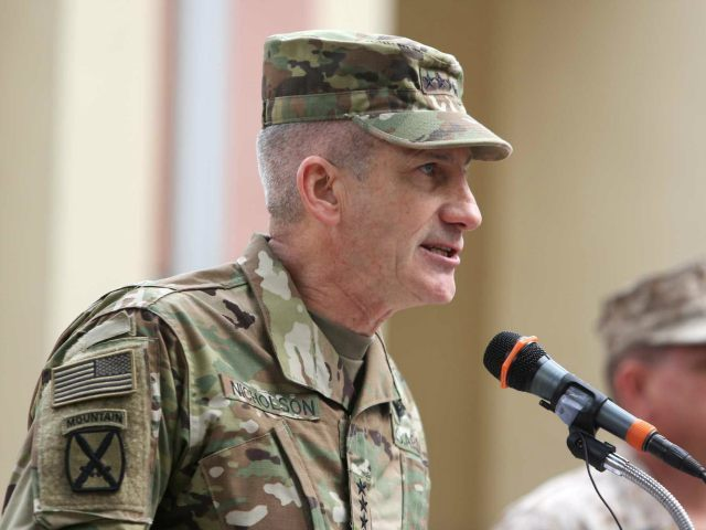 New Commander of Resolute Support forces and United States forces in Afghanistan, U.S. Army General John Nicholson, speaks during a change of command ceremony in Resolute Support headquarters in Kabul, Afghanistan, Wednesday, March 2, 2016. (AP Photo/Rahmat Gul)