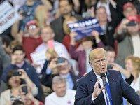 Donald Trump speaks during a rally at the International Exposition Center March 12, 2016 in Cleveland, Ohio. Donald Trump is under fire from rivals who blamed his incendiary rhetoric for a violent outbreak Friday between protesters and supporters at the Republican frontrunner's rally in Chicago. / AFP / Brendan Smialowski …