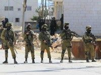 Israeli security forces hold position near the Jewish settlement of Kiryat Arba in the occupied West Bank