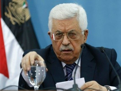 President Mahmoud Abbas reacts during a meeting with Palestinian journalists in the West Bank city of Ramallah, on January 23, 2016. /