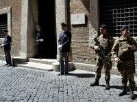 Policemen and soldiers stand guard outside the Italian national Anti-mafia services (Direzione Nazionale Antimafia - DNA) headquarters on May 7, 2015 in Rome.