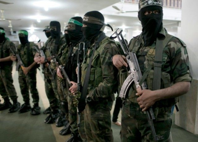 Members of the Ezzedine al-Qassam Brigades, the military wing of the Palestinian Islamist movement Hamas, take part in the funeral of a Palestinian fellow militant in Khan Yunis in the southern Gaza Strip on March 4, 2016