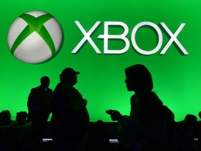 People walk past the Xbox section at the Electronic Entertainment Expo, an annual video game conference at the Los Angeles Convention Center on June 16, 2015