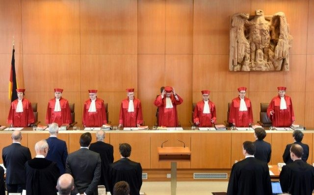 Judges of the first senate of the Federal Constitutional Court in Karlsruhe, southwestern Germany, arrive to open a hearing on the German nuclear phase-out on March 15, 2016