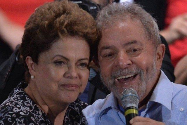 Brazilian President Dilma Rousseff (L) and former president Luiz Inacio Lula da Silva attend a campaign rally in Sao Paulo, Brazil on October 20, 2014