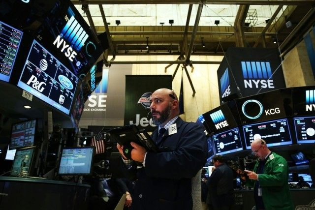 Traders work on the floor of the New York Stock Exchange (NYSE) on March 11, 2016