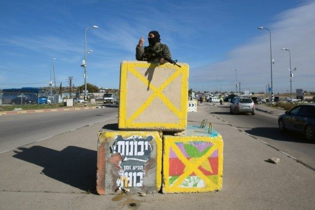 Gush Etzion junction, a major intersection near a large block of Israeli settlements in the southern West bank, is a major hub for hitchhiking soldiers and settlers