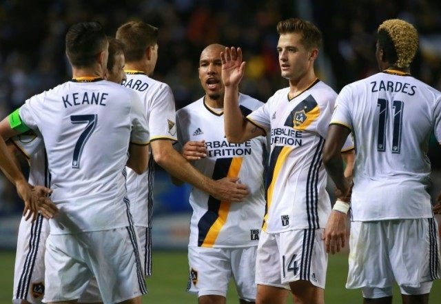 Robbie Keane, Mike Magee, Steven Gerrard, Nigel de Jong, Robbie Rogers and Gyasi Zerdes of Los Angeles Galaxy celebrate after scoring a goal against D.C. United, at StubHub Center in Carson, California, on March 6, 2016