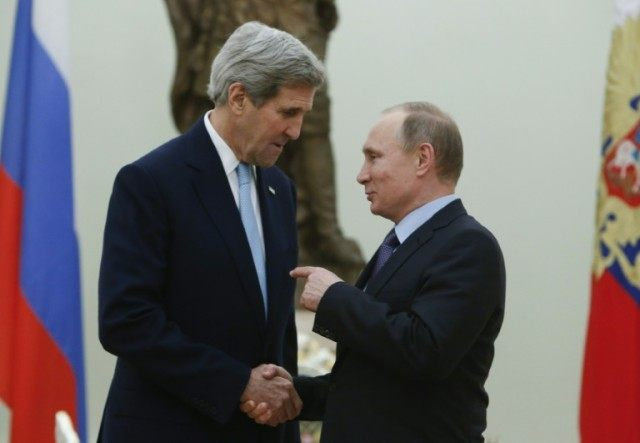 Russian President Vladimir Putin (R) speaks with US Secretary of State John Kerry during a meeting at the Kremlin in Moscow on December 15, 2015