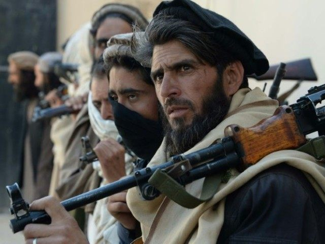 Afghan alleged former Taliban fighters hand over their weapons as part of a government peace and reconciliation process in Jalalabad on February 24, 2016