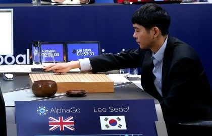 Lee Se-Dol, one of the greatest modern players of the ancient board game Go, makes a move during the third game of the Google DeepMind Challenge Match against Google-developed supercomputer AlphaGo