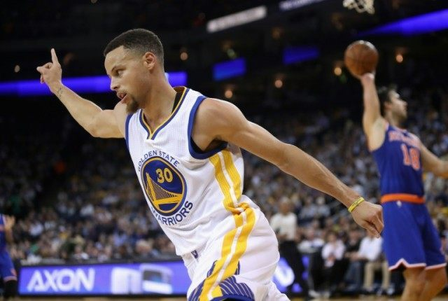Stephen Curry of the Golden State Warriors celebrates after making a basket  during their NBA game 92bcb308b3b