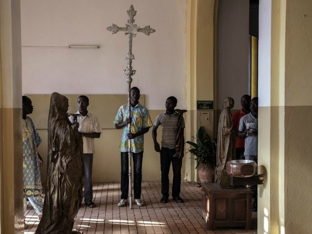 Catholic worshippers rehears proceedings in the capitol main Cathedral Notre Dame during preparation and rehearsal for Pope Francis visit on November 25, 2015 in Bangui, Central African Republic.