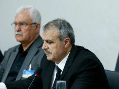 Members of the delegation of the High Negotiations Committee (HNC) Mohamed Alloush Asaad Al-Zoubi (C) and George Sabra wait prior to a meeting with U.N. mediator during Syria peace talks at the United Nations in Geneva, on March 17, 2016.