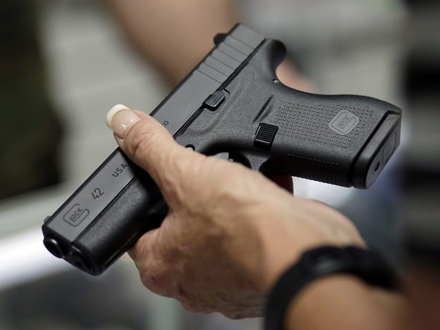 Sally Abrahamsen, of Pompano Beach, Fla., right, holds a Glock 42 pistol while shopping for a gun at the National Armory gun store and gun range, Tuesday, Jan. 5, 2016, in Pompano Beach, Fla. President Barack Obama unveiled his plan Tuesday to tighten control and enforcement of firearms in the …
