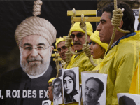 People hold placards displaying portaits as they take part in a demonstration denouncing Iran's use of the death penalty on January 28, 2016 in Paris, organised to coincide with the official visit to France by the Iranian President.