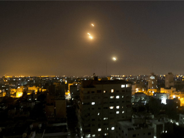 A picture taken from Gaza city shows a long-range J-80 rocket being launched from the Gaza strip towards Israel on July 12, 2014 following an advance warning of the attack by Ezzedine al-Qassam Brigades, the military wing of Hamas.