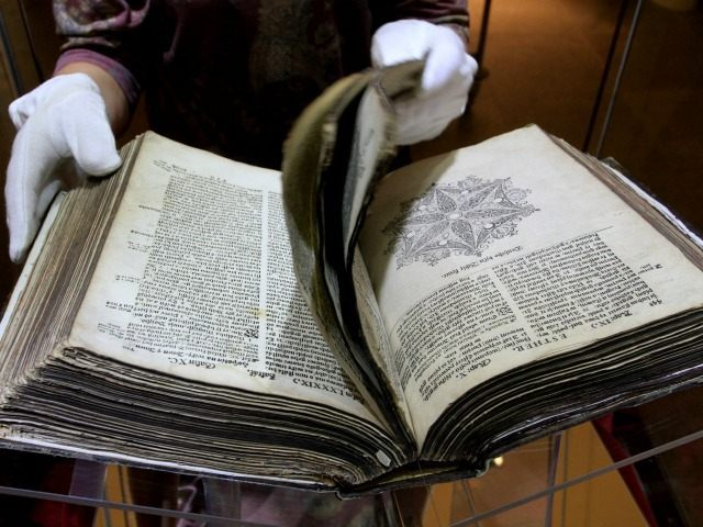 A worker prepares the 400-year-old Kralice's Bible, on September 27, 2013 to be exhibited in the Dietrichstein Palace in Brno during an exhibition marking the 400th anniversary of the last edition of the Kralice's Bible.