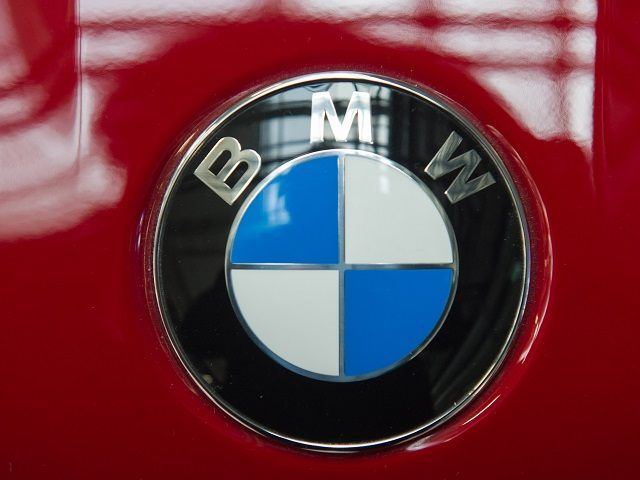 MUNICH, GERMANY - MARCH 07: A logo of German automaker BMW in seen during the celebration marking the 100th anniversary of BMW on March 7, 2016 in Munich, Germany. BMW began as a producer of aircraft engines in Germany during World War I, later began producing motorcycles and in 1928 …