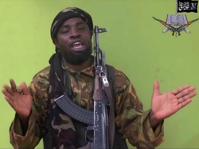 FILE -This May 12, 2014, file photo taken from video by Nigeria's Boko Haram terrorist network, shows their leader Abubakar Shekau speaking to the camera. Islamic State militants have accepted a pledge of allegiance by the Nigerian-grown Boko Haram extremist group, a spokesman for the Islamic State movement said Thursday, …