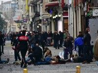 Graphic content / Injured people get assistance on the scene of an explosion on the pedestrian Istiklal avenue in Istanbul on March 19, 2016. A suicide bombing ripped through a famous shopping street in central Istanbul killing four people and injuring dozens less than a week after an attack by …