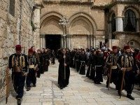 Kawases in traditional Ottoman outfits lead a procession of Roman Catholic clergymen as they leave the Church of the Holy Sepulchre in Jerusalem's Old City during Holy Thursday (Maundy Thursday) celebrations on March 24, 2016.