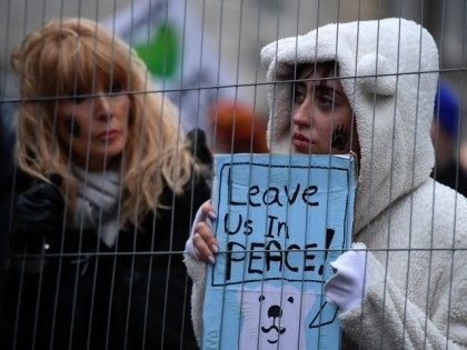 Climate change demonstrators march to demand curbs to carbon pollution in London on November 29, 2015 on the eve of the climate summit in Paris.