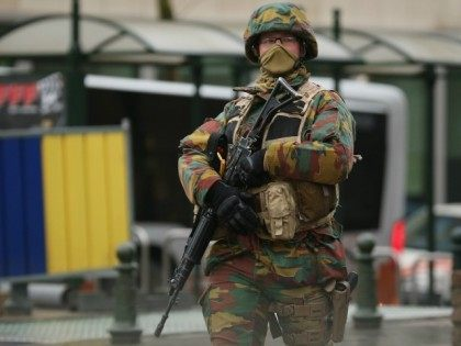 n armed soldier patrols near the EU Commission Headquarters in after yesterday's terrorist attacks on March 23, 2016 in Brussels, Belgium. Belgium is observing three days of national mourning after 34 people were killed in a twin suicide blast at Zaventem Airport and a further bomb attack at Maelbeek Metro …