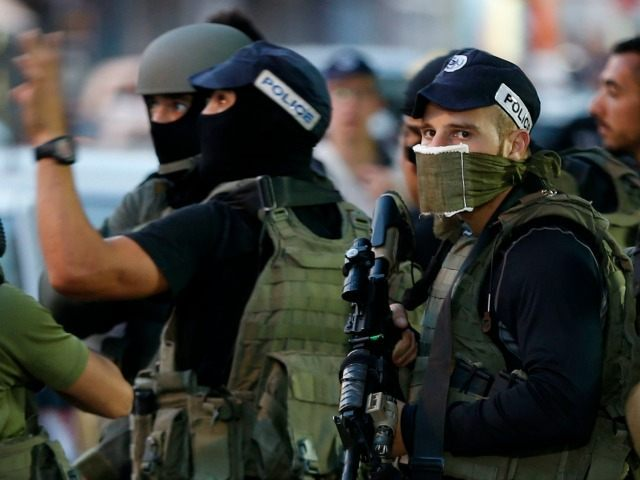 Israeli security forces gather in East Jerusalem's Salahedin street following a shooting attack on March 8, 2016. A Palestinian shot and seriously wounded two Israeli police officers in Jerusalem before being shot dead, Israeli authorities and medics said, as a five-month wave of attacks persisted