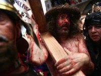 American Christian pilgrims re-enact the crucifixion of Jesus along the Via Dolorosa, the route tradition says Jesus carried the cross on which he was to be crucified by the Romans, during the Good Friday procession on April 2, 2010 in Jerusalem's Old City.